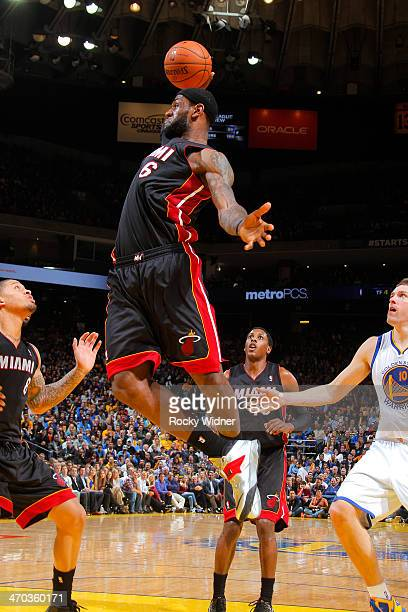 LeBron James of the Miami Heat rebounds against the Golden State Warriors on February 12 2014 at Oracle Arena in Oakland California NOTE TO USER User...