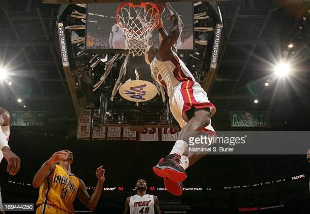 LeBron James of the Miami Heat reverse dunks against George Hill of the Indiana Pacers in Game Two of the Eastern Conference Finals on May 24 2013 at...