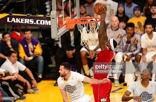 LeBron James of the Miami Heat scores under pressure from Jordan Farmer of the Los Angeles Lakers during their Christmas Day matchup at Staples...
