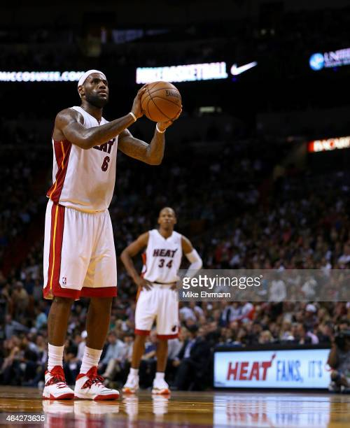 LeBron James of the Miami Heat shoots a free throw during a game against the Boston Celtics at AmericanAirlines Arena on January 21 2014 in Miami...