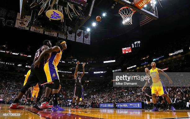 LeBron James of the Miami Heat shoots a free throw during a game against the Los Angeles Lakers at American Airlines Arena on January 23 2014 in...