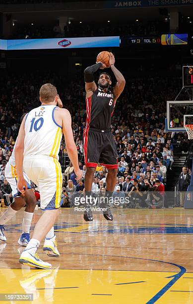 LeBron James of the Miami Heat shoots against David Lee of the Golden State Warriors on January 16 2013 at Oracle Arena in Oakland California NOTE TO...