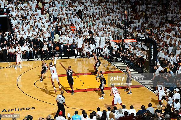 LeBron James of the Miami Heat shoots against Kawhi Leonard of the San Antonio Spurs during Game Seven of the 2013 NBA Finals on June 20 2013 at...