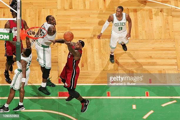 LeBron James of the Miami Heat shoots against Kendrick Perkins of the Boston Celtics on February 13 2011 at the TD Garden in Boston Massachusetts...
