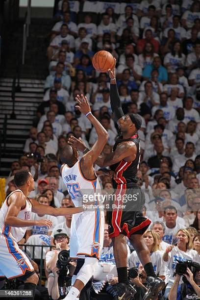 LeBron James of the Miami Heat shoots against Kevin Durant of the Oklahoma City Thunder during Game Two of the 2012 NBA Finals at Chesapeake Energy...