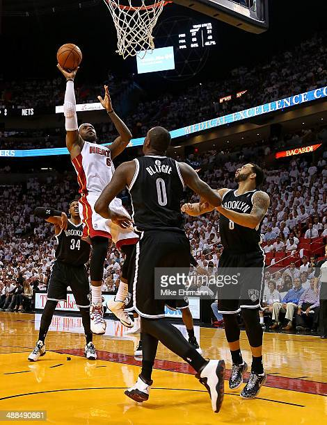 LeBron James of the Miami Heat shoots over Andray Blatche of the Brooklyn Nets during Game One of the Eastern Conference Semifinals of the 2014 NBA...