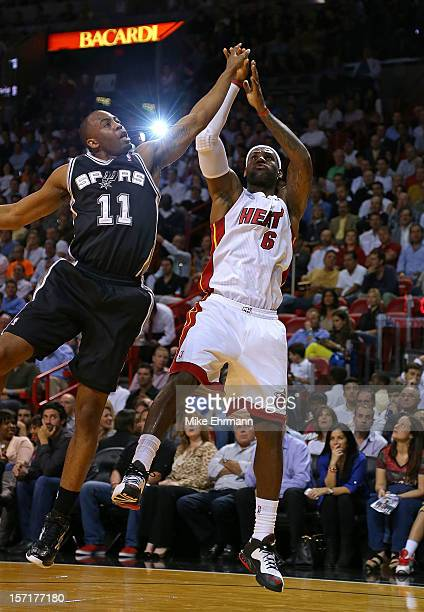 LeBron James of the Miami Heat shoots over James Anderson of the San Antonio Spurs during a game at American Airlines Arena on November 29, 2012 in...