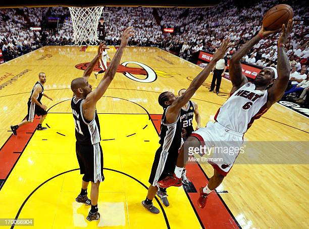 LeBron James of the Miami Heat shoots over Kawhi Leonard of the San Antonio Spurs in the third quarter during Game One of the 2013 NBA Finals at...