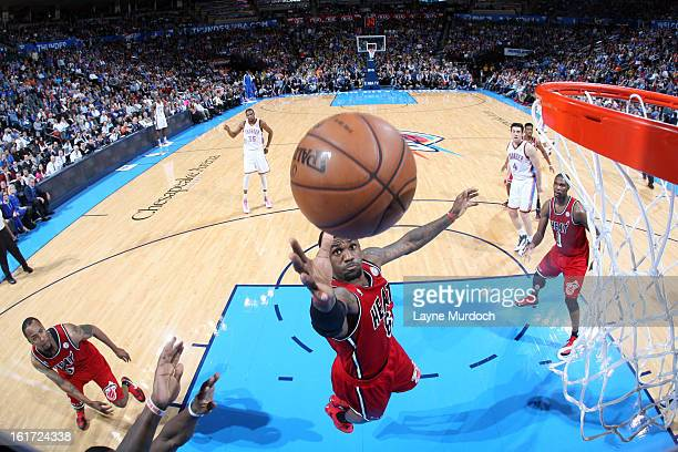 LeBron James of the Miami Heat shoots over the Oklahoma City Thunder during an NBA game on February 14 2013 at the Chesapeake Energy Arena in...