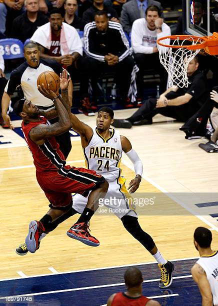 LeBron James of the Miami Heat shoots the ball against Paul George of the Indiana Pacers in Game Six of the Eastern Conference Finals during the 2013...