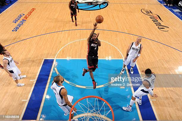 LeBron James of the Miami Heat shoots the ball against the Dallas Mavericks in Game Five of the 2011 NBA Finals on June 9 2011 at the American...
