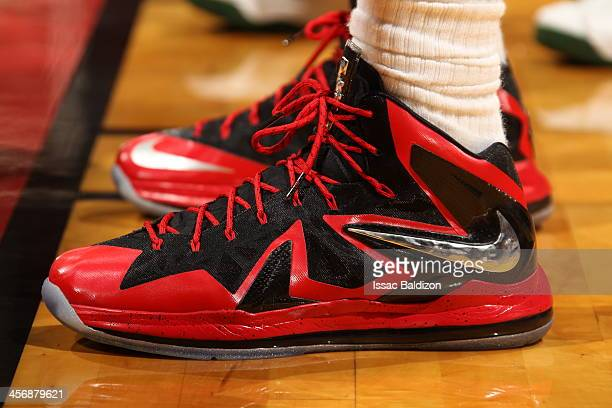 LeBron James of the Miami Heat showcases his sneakers against the Boston Celtics on November 9 2013 at American Airlines Arena in Miami Florida NOTE...