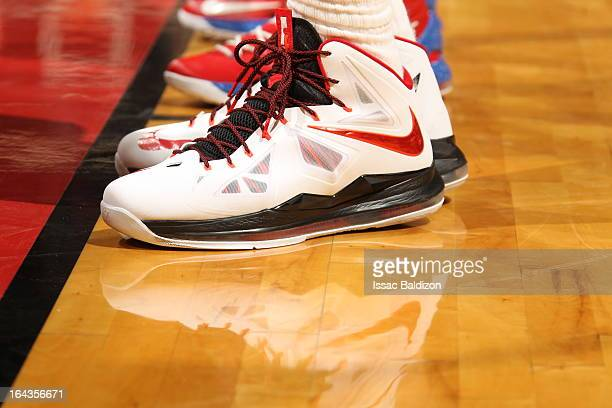 LeBron James of the Miami Heat shows of his sneakers during the game against the Detroit Pistons on March 22 2013 at American Airlines Arena in Miami...
