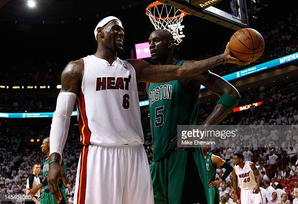 LeBron James of the Miami Heat smiles as he holds out the ball in the second half against Kevin Garnett of the Boston Celtics in Game One of the...