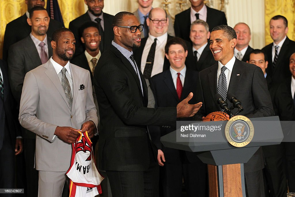 LeBron James #6 of the Miami Heat speaks to President Barack Obama during a visit by the Miami Heat to the White House to commemorate the 2012 NBA Champions on January 28, 2013 in Washington, DC.