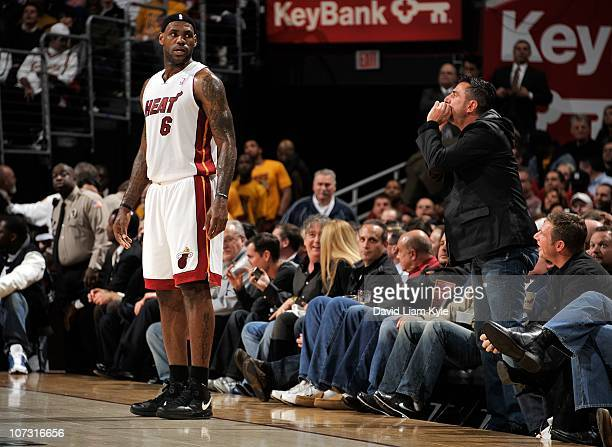 LeBron James of the Miami Heat stands on the court as fans react to his return to Cleveland during a game against the Cleveland Cavaliers at The...