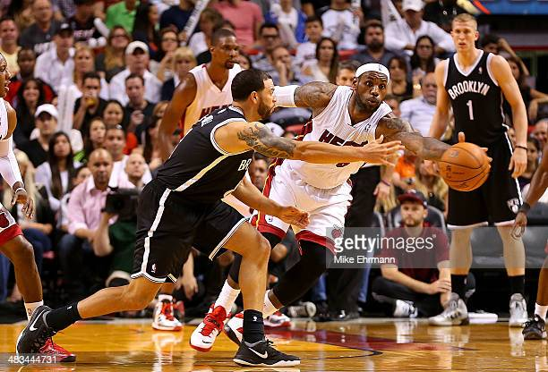 LeBron James of the Miami Heat steals a pass from Deron Williams of the Brooklyn Nets during a game at AmericanAirlines Arena on April 8 2014 in...