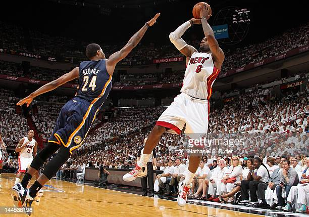 LeBron James of the Miami Heat takes a jump shot over Paul George of the Indiana Pacers in Game Two of the Eastern Conference Semifinals during the...