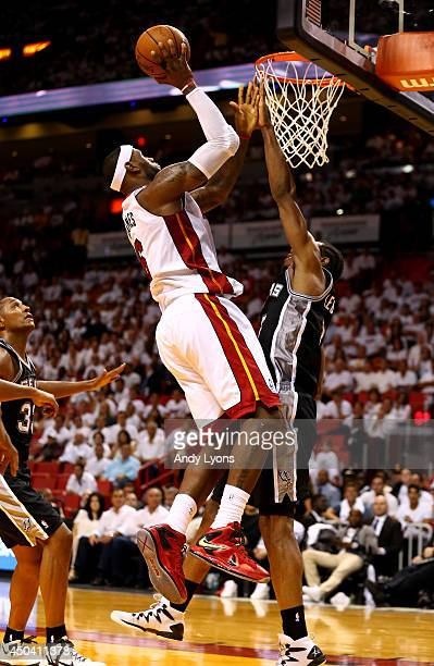 LeBron James of the Miami Heat takes a shot over Kawhi Leonard of the San Antonio Spurs during Game Three of the 2014 NBA Finals at American Airlines...