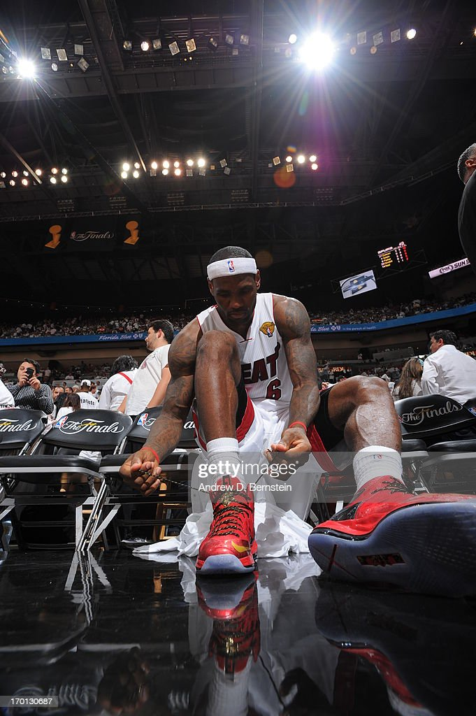 206c3c1fb8256 LeBron James of the Miami Heat ties his sneakers against the San ...