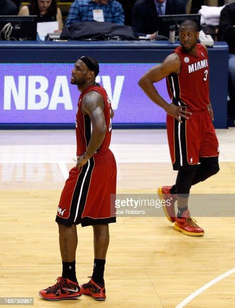 LeBron James of the Miami Heat walks to the bench after being taken out towards the end of the fourth period in Game Six of the Eastern Conference...