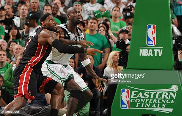LeBron James of the Miami Heat watches the loose ball against Kevin Garnett of the Boston Celtics in Game Three of the Eastern Conference Finals...