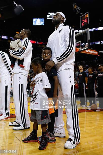 LeBron James of the Miami Heat with his sons Bryce James and LeBron James Jr stand for the national anthem prior to the game against the Washington...