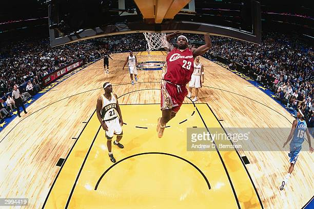 LeBron James of the Rookie Team drives to the basket for a dunk against the Sophomore Team during the Got Milk Rookie Challenge a part of the 2004...