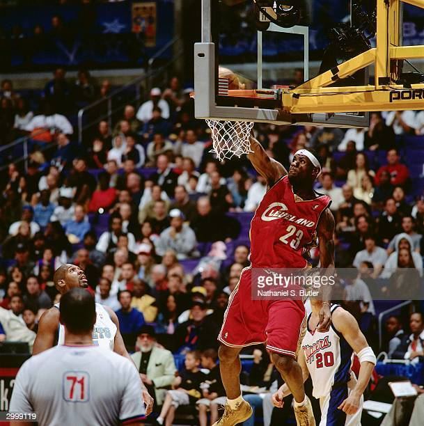 LeBron James of the Rookie Team dunks against the Sophomore Team during the got milk Rookie Game on February 13 2004 at Staples Center in Los Angeles...