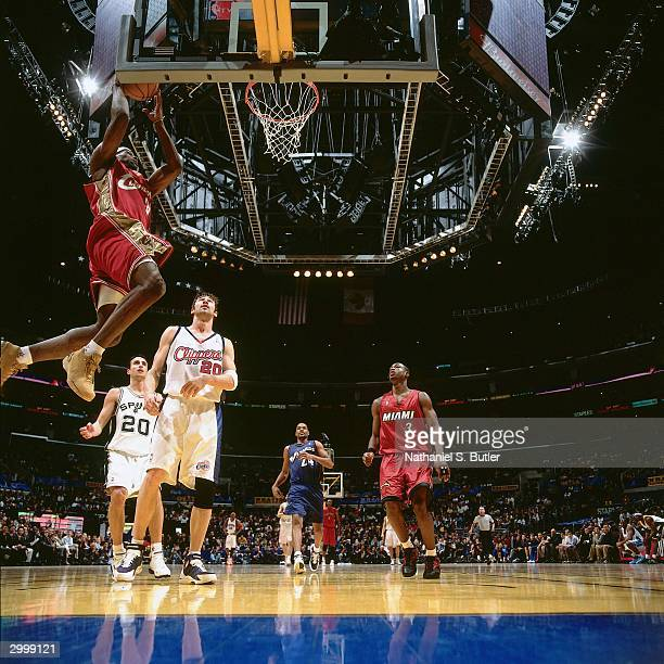 LeBron James of the Rookie Team dunks against the Sophomore Team during the got milk? Rookie Game on February 13, 2004 at Staples Center in Los...