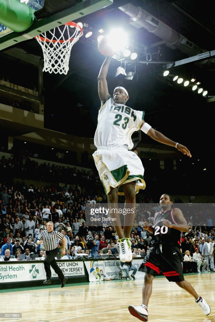 LeBron James #23 of the St. Vincent-St. Mary Fighting Irish goes up for a slam dunk during the game against the LA Westchester Comets in the Primetime Shoot out at Sovereign Bank Arena on February 8, 2003 in Trenton, New Jersey. The Irish won 78-52.