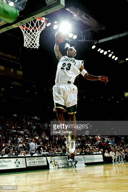 LeBron James of the St VincentSt Mary Fighting Irish goes up for a slam dunk during the game against the Los Angeles Westchester Comets in the...