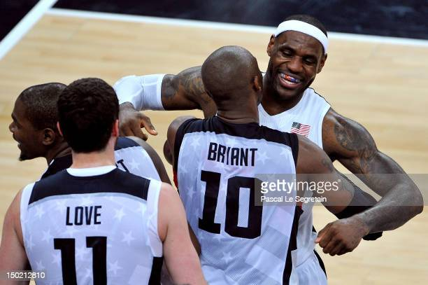 LeBron James of the United States celebrates winning the Men's Basketball gold medal game between the United States and Spain with teasm mate Kobe...