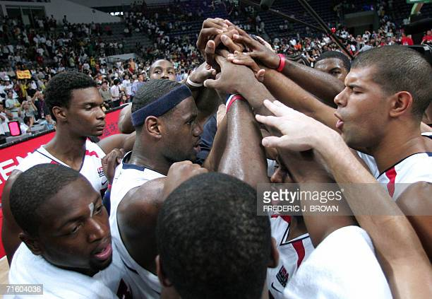 LeBron James of the United States celebrates with his teammates including Chris Bosh Dwyane Wade and Shane Battier following a close victory over...