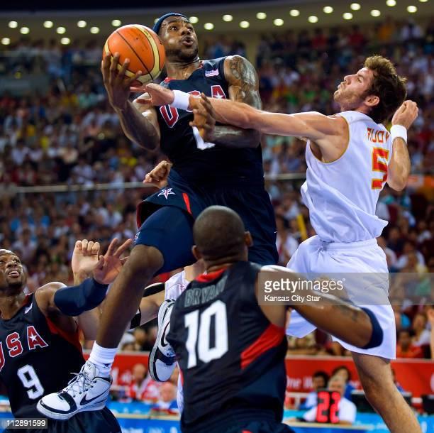 LeBron James of the United States drives against Rdy Fernandez of Spain in the gold medal basketball game on Sunday August 24 in the Games of the...