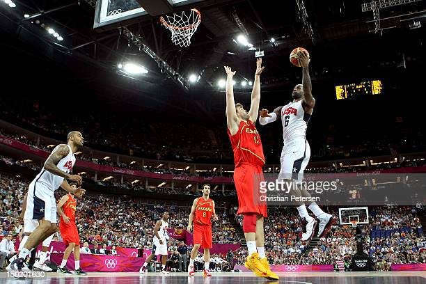 LeBron James of the United States drives for a shot attempt against Marc Gasol of Spain during the Men's Basketball gold medal game on Day 16 of the...