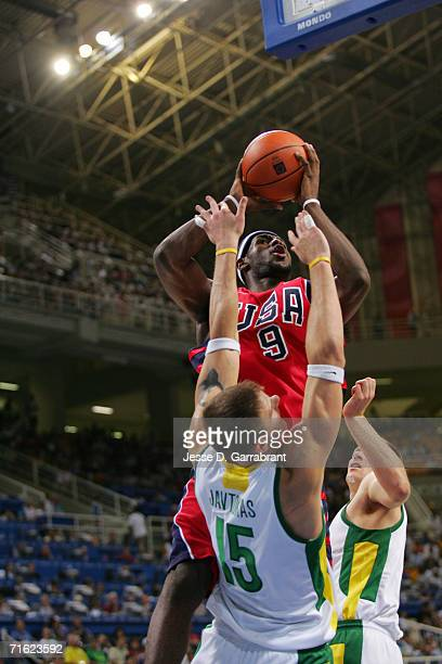 Lebron James of the United States goes up for a shot over Robertas Javtokas of Lithuania in the men's basketball bronze medal contest game on August...