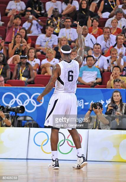 LeBron James of the U.S. Men's Senior National Team celebrates against Germany during the men's group B basketball preliminaries at the 2008 Beijing...
