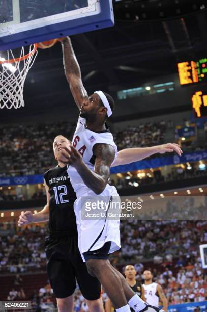 LeBron James of the U.S. Men's Senior National Team dunks against Chris Kaman of Germany during the men's group B basketball preliminaries at the...