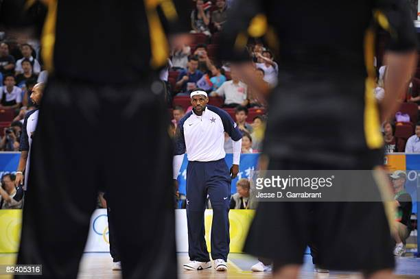 LeBron James of the U.S. Men's Senior National Team looks on during the game against Germany during the men's group B basketball preliminaries at the...
