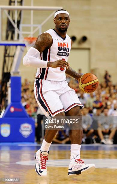 LeBron James of the US Men's Senior National Team runs the ball during a PreOlympic Men's Exhibition Game between USA and Argentina at Palau Sant...