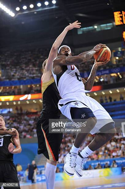 LeBron James of the U.S. Men's Senior National Team shoots against Germany during the men's group B basketball preliminaries at the 2008 Beijing...