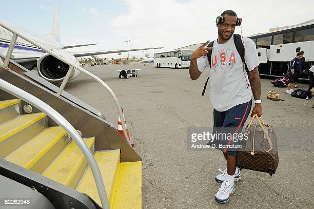 LeBron James of the USA Basketball Men's Senior National Team boards the plane traveling to the 2008 Beijing Summer Olympics on July 26, 2008 in...