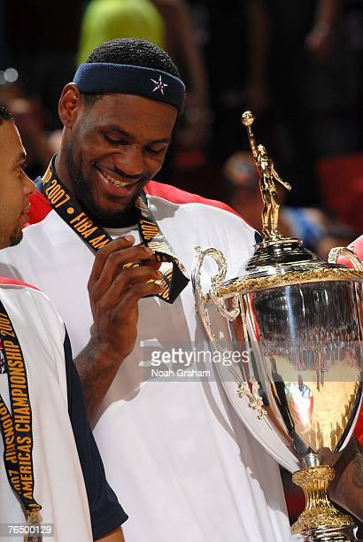 LeBron James of the USA Men's Senior National Team admires his medal during the medal ceremony after defeating Argentina during the gold medal game...