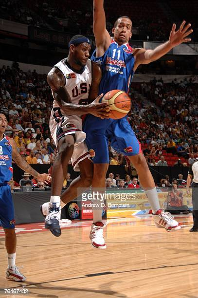 LeBron James of the USA Men's Senior National Team passes against Ricardo Sanchez of Puerto Rico during the semi-finals of the 2007 FIBA Americas...