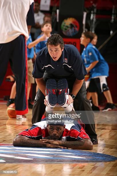 LeBron James of the USA Men's Senior National Team stretches prior to their game against Puerto Rico during the second round of the 2007 FIBA...