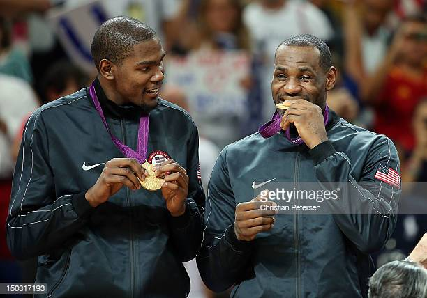 Lebron James of United States bites his gold medal after defeating Spain in the Men's Basketball gold medal game on Day 16 of the London 2012...