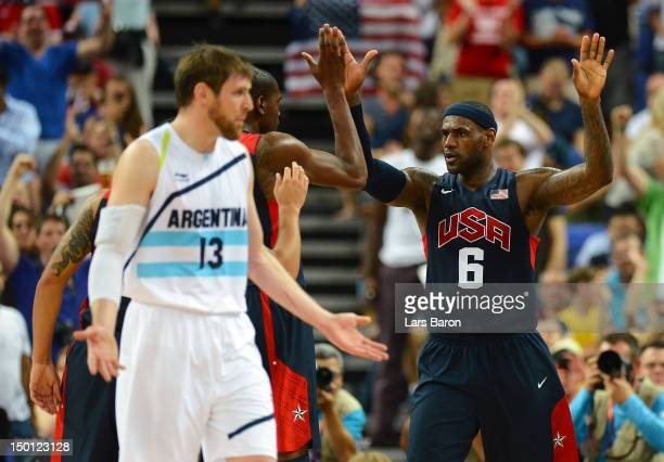 LeBron James of United States celebrates a play with Kevin Durant as Andres Nocioni of Argentina reacts in the second half during the Men's...