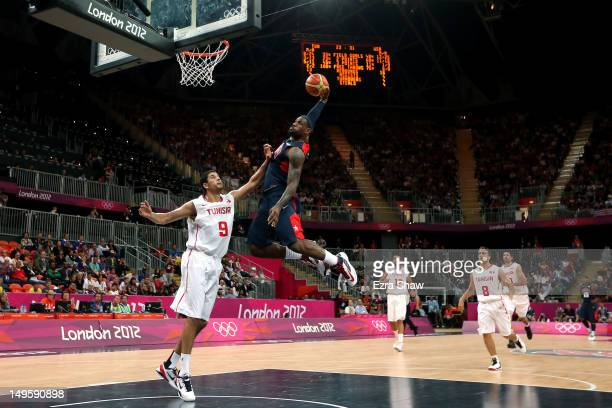 Lebron James of United States dunks the ball over Mohamed Hadidane of Tunisia during the Men's Basketball Preliminary Round match on Day 4 of the...
