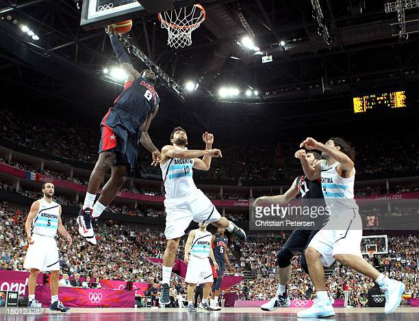 LeBron James of United States goes up for a dunk over Carlos Delfino of Argentina in the second half during the Men's Basketball semifinal match on...